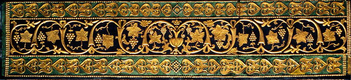 Gilt repousse on tie-beam